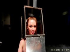 sadomasochism hottie with head in steel box spaked