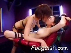 oriental lesbos giving a kiss and swapping spit