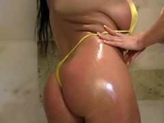 soaked and oiled breasty bikini milfs play in the