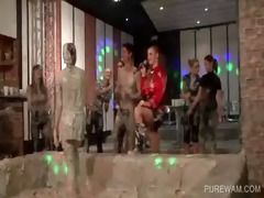 impure party women have fun fighting in bawdy mud