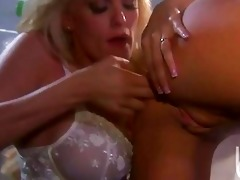 atractive blond lesbos with large hooters having
